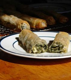 Don& these look so delicious? I love Spanakopita, Greek Spinach Pie, and I always order it at any Greek restaurant I am fortunate enough t. Greek Spinach Pie, Spinach And Feta, Spinach Leaves, Spinach Ideas, Spinach Rolls, Sauteed Spinach, Spanakopita Recipe, Tapas, Greek Dinners