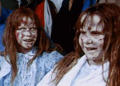 Linda Blair on set of The Exorcist with her dummy double and make-up artist Dick Smith.