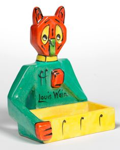 """Louis Wain"" Futurist Cat, design registered 1914, modelled holding a tray, painted yellow, green, red and black, printed, painted and moulded marks, including trident mark, Louis Wain, Made in England, Reg. No. 643807, 13cm."