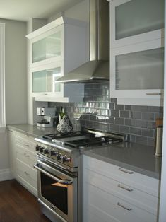 I like the high gloss tiles and cabinets which should work well in a small kitchen