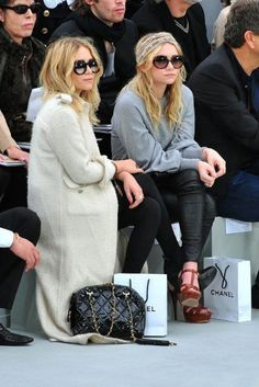 Only they could make looking schleppy the new chic.. and, front row at a Chanel show. #respect