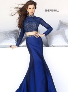 Sherri Hill style 32044. Gorgeous navy two-piece. Beaded long sleeve, high neck crop top and a mermaid skirt with a beaded waistband.