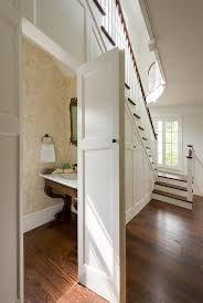 Znalezione obrazy dla zapytania stairway hidden cupboard