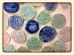 Fresh from the kiln, Gr. 1 Snowflakes | WEST MIDDLETON ART SMARTIES, snowflakes drawn on foam, Clay ball pressed on top, glaze mixed with lots of clear