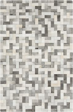 An Outback Collection rug from Surya is the ultimate masculine statement. Hand crafted from natural hides. From Surya. (OUT-1012)