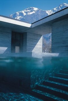 Therme Vals by Peter Zumthor (thermal baths). This complex is integrated into the landscape so perfectly, and it's beautifully designed. Would love to visit here someday!: