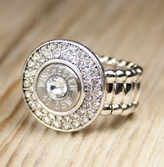 Fire & Ice 40 Caliber Bullet Ring. I REALLY REALLY REALLY NEED THIS