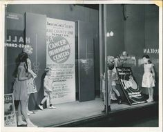 This photograph depicts a beautiful American Cancer Society window display.  It is from the Lake County Unit, Gary IN.  It is dated 1948 on the back.  From my personal collection.