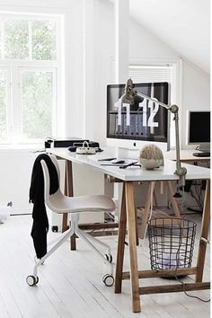 White desk on trestles.