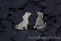 Cute little handmade sterling silver dog stud earrings. These dogs are really quite small, measuring 0.6-0.7 cm wide by 0.9-1.0 cm high.   Each dog has been hand cut from a sheet of Argentium silver using a jewellery saw. These earrings have a brushed matte finish.