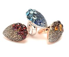 Rodney Rayner rings from the Comet collection (left to right): pavé diamond and pavé champagne diamond, rhodolite and garnet ring, set in red gold; pavé diamond, sapphire and topaz ring, set in white gold; pavé diamond, champagne diamond, citrine and smoky quartz ring, set in red gold.