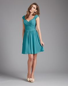 This bridesmaid dress features criss-crossed ruching along the bodice, with contour straps.  Would flatter most shapes.  From Allure Bridal.