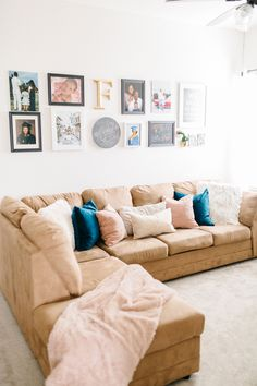 Struggling with your family room decor? Take a look at how we decorated our modern family room to turn our house into a home and make it even more special. Family Room Sectional, Modern Family Rooms, Family Room Decorating, Mom Blogs, Gallery Wall, Couch, Furniture, Home Decor, Homemade Home Decor