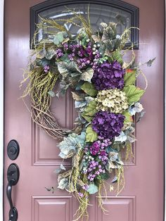 Beautiful Summer Wreath Design Ideas To Try Asap 48 When most of us think of front door wreaths we think circle, evergreen and Christmas. Wreaths come in all types … Purple Wreath, Floral Wreath, Diy Wreath, Grapevine Wreath, Wreath Ideas, Outdoor Wreaths, Hydrangea Wreath, Arte Floral, Holiday Wreaths