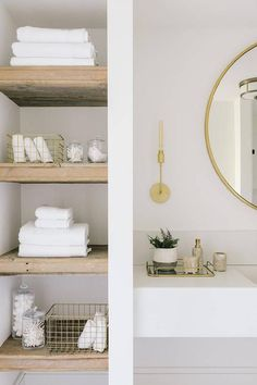 Tall bathroom nook fitted with reclaimed wood shelves displaying towels and decor beside a white floating sink vanity. Attic Bathroom, Upstairs Bathrooms, Downstairs Bathroom, Small Bathroom, Bathroom Ideas, Floating Shelves Bathroom, Bathroom Towel Display, Bathroom Storage Shelves, Floating Sink