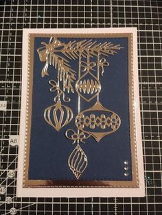handmade Christmas card ... gold foil die cut baubles hanging from die cut branches ... luv the look on navy/black ...