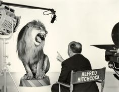 """Alfred Hitchcock turning his back on MGM. (Hitchcock may also be backing into the lot.) Alfred Hitchcock and what I suppose is the (or """"an. Alfred Hitchcock, Mgm Lion, Tv Movie, Pier Paolo Pasolini, Metro Goldwyn Mayer, Cinema Tv, Roaring Lion, Lion Logo, Poster S"""