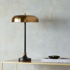 Porcini table lamp in black base and brass hood