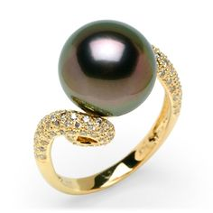 black pearl on gold twist band and small diamonds