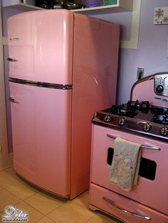 """Dita Von Teese's retro kitchen.and yet more reasons to love Dita! But """"I"""" HAVE TO HAVE a black and white checkered floor with my retro appliances:) Pink Kitchen Appliances, Vintage Appliances, Pink Kitchens, Smeg Kitchen, Paint Appliances, Cleaning Appliances, Kitchen Oven, White Appliances, Basement Kitchen"""
