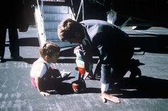 John, Jr. and his father enjoy an intimate moment playing together on the tarmac just outside the helicopter stairs upon JFK's arrival to Camp David.