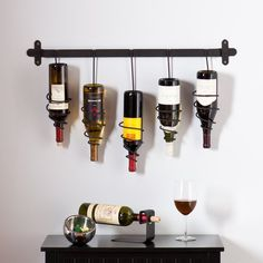 This unique wall mount wine rack utilizes unused wall space and stores your wine at the same time. Five coil holders store bottles upside down, allowing your favorite labels to be visible. Create a one of a kind artwork using your most prized wine bottles. The natural wrought iron finish gives this wall mount a charmingly industrial touch. This functional art is a perfect gift for wine lovers!