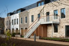 Image 11 of 37 from gallery of Marmalade Lane Cohousing Development / Mole Architects. Photograph by David Butler Mole, Alcacer Do Sal, Co Housing, Social Housing, Porch And Balcony, Timber Structure, Dormer Windows, Affordable Housing, England
