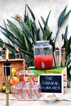 The Shark Puncher is a perfect recipe for a serving a large party. Just mix Captain Morgan coconut rum, orange juice, grape fruit juice and cranberry juice.