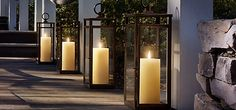 These large lanterns are placed along the walkway with candles. Very effective and beautiful. An elegant touch for a yard, deck or outdoor party.