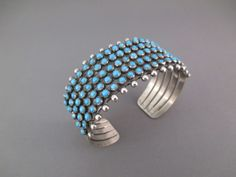 Sterling Silver & Sleeping Beauty Turquoise Cuff Bracelet by Navajo jeweler, Paul Livingston. Substantial sterling and 95 Sleeping Beauty Turquoise stones!