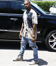fdf10e629 Kanye West Spotted In Miami Wearing Fear of God Jeans And Yeezy Boost 750  Sneakers
