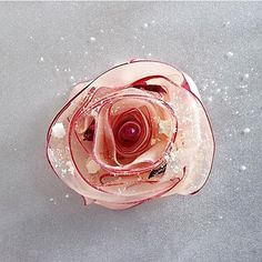 White nectarine rose, soft nougat, caramelized puff pastry, vanilla cream, and…