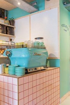pastel green coffee machine, pink tiles, pegboard, 400 rabbits pizza restaurant
