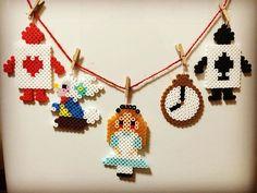 Alice in Wonderland garland perler beads by komamiiho Diy Garland, Beaded Garland, Beaded Ornaments, Seed Bead Patterns, Perler Patterns, Beading Patterns, Bead Crafts, Diy Crafts, Perler Bead Disney
