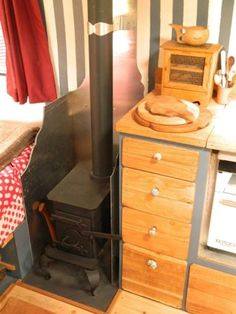 small space (by bed) Wood burning stove