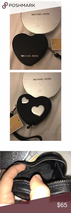NWT Michael Kors wristlet New with tags Michael Kors heart wristlet in black. 100% authentic offers welcome!❤ Michael Kors Bags Clutches & Wristlets