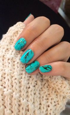 Amazing. It looks like turquoise. See more summer nails by following the link.