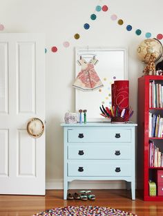Four-year-old daughter Grace's bedroom, designed in collaboration with Jacinda Malloy of Hide and Sleep. Chest of drawers – a second hand score from eBay which Suzanne painted, crochet bunting by Crayon Chick, paper dress by Marcelle Crosby, and lamp from Bholu. Photo – Eve Wilson, production – Lucy Feagins / The Design Files.