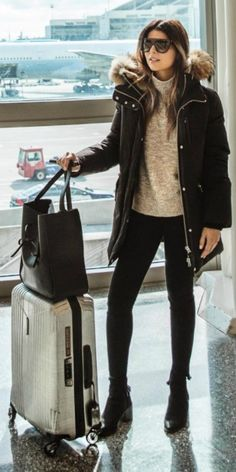 Pam Hetlinger + killing this + classic travel style + skinny jeans + knit sweater + thick black puffer jacket + minimalist luggage + pair of shades + perfect regardless of where you're jetting off to! Coat: Marla, Jumper: Nordstrom.
