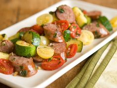 Sweet Italian Sausage with Zucchini and Tomatoes-Garnish this delicious combination of summer vegetables and Italian sausage with sprigs of fresh basil and lemon wedges to squeeze over the top, if you like. Ingredients with an asterisk (*) are available in the  Whole Foods Market Family of Brands.