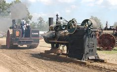Case steam tractor pulling a stationary engine