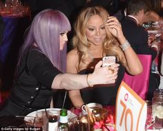 Say cheese: Kelly grabbed a selfie with Mariah