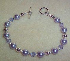 """ovence Lavender Swarovski Crystals & Lavender Pearls. Bracelet Fits up to a 7.5"""" wrist."""