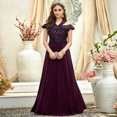 Earn lots of compliments wearing this designer floor length gown in wine color fabricated on fancy fabric and work. This pretty gown is light in weight and easy to carry all day long. Party Wear Dresses, Party Gowns, Eid Dresses, Designer Gowns, Indian Designer Wear, Designer Anarkali, Latest Gown Design, Cold Shoulder Gown, Simple Gowns