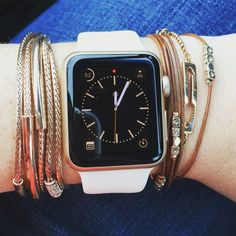 How to style an Apple Watch with layered bracelets.  Love this!