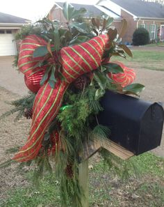 Christmas 2013 - a big Red & Green Deco Mesh Bow decorates this mailbox along with Greenery and Red & Green Ornaments.