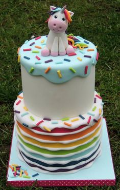 Rainbow stripe unicorn birthday celebration cake with drippy icing effect and sprinkles