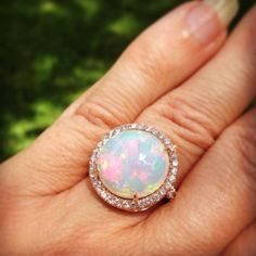 Kimberly Collins Colored Gems 7.71ct Opal and diamond ring in 18k rose gold.