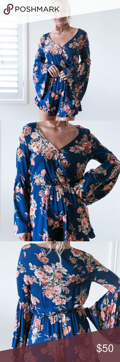 STAND ALONE Playsuit Romper // Navy DETAILS - ships out week of 6/19Navy and floral print playsuitV-neckline with press studRelaxed fitElastic waistLong, bell style sleeves MODEL INFORMATION Model:Michaela Dress Size:8 (AU)Height:174cmBust:86cmWaist: 66cmHips: 89cmShoe: Size 8 Pants Jumpsuits & Rompers