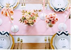 Pink + gold table setting. Navy and white chevron napkins and gold utensils. Peach, pink and cream flowers.